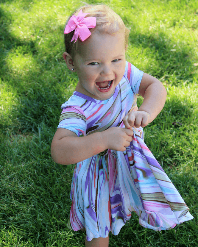 0310db3afda5 Caitlin is 2 years old and wearing the Classic Cap Dress in a size 2.  Typically